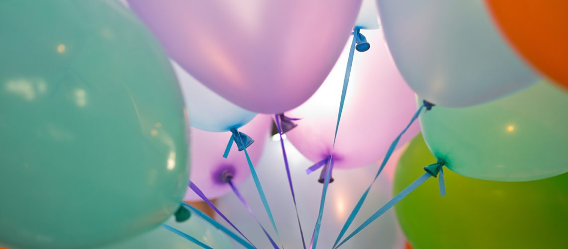 close-up-of-multi-colored-helium-balloons-DZQ2B6B
